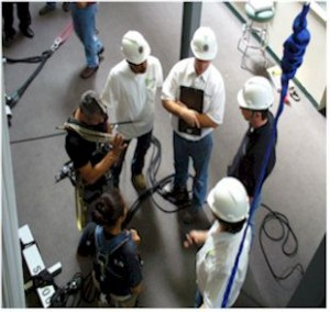 students in hard hats and safety gear